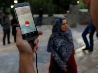 An Iranian man plays on the Pokemon Go app in northern Tehran's Mellat Park on August 3, 2016. / AFP / ATTA KENARE (Photo credit should read ATTA KENARE/AFP/Getty Images)