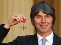 Physicist Brian Cox, poses with his OBE (Order of the British Empire), after he was awarded it by Britain's Queen Elizabeth II, during an Investiture ceremony at Buckingham Palace in London on October 21, 2010. AFP PHOTO/Dominic Lipinski/Pool (Photo credit should read Dominic Lipinski/AFP/Getty Images)