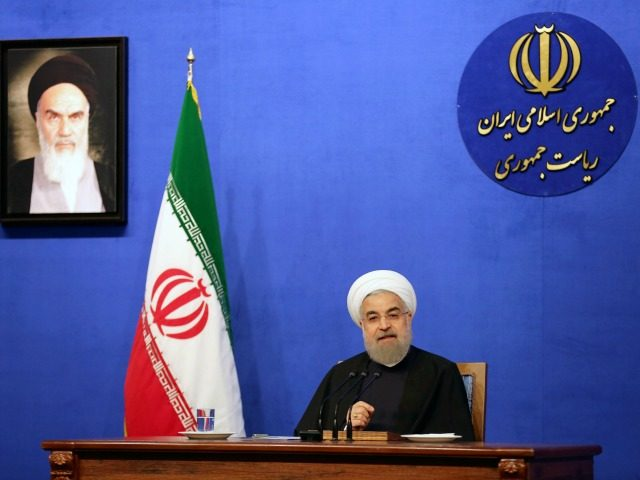 Iranian President Hassan Rouhani speaks during a press conference next to a frame bearing a portrait of the late founder of the Islamic Republic, Ayatollah Ruhollah Khomeini, on March 6, 2016 in the capital Tehran. Rouhani promised that 2016 will be a better year, weeks after Tehran's nuclear deal took …