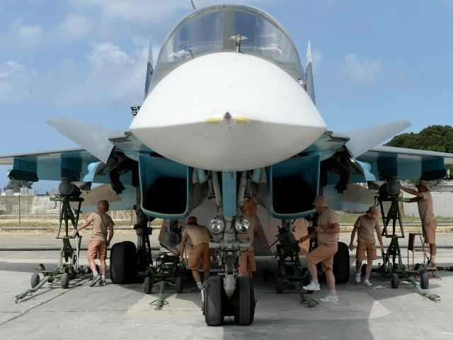 Russian servicemen prepare an SU-34 fighter jet for a mission from the Russian Hmeimim military base in Latakia province, in the northwest of Syria on May 4, 2016. Syria's conflict erupted in 2011 after anti-government protests were put down. Fighting quickly escalated into a multi-faceted war that has killed more …