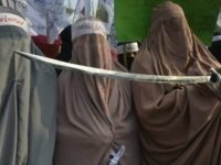 Pakistan women demonstrators wear burqas and hold a sword in protest against the printing of satirical sketches of the Prophet Muhammad by French magazine Charlie Hebdo, in Lahore on January 20, 2015. Pakistan's parliament on January 15 condemned French satirical magazine Charlie Hebdo for printing a 'blasphemous' cartoon of the …