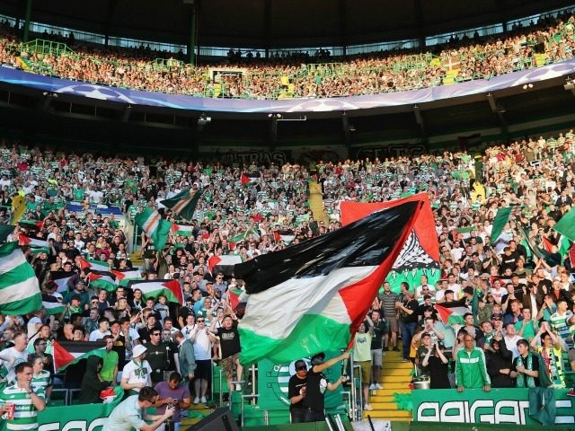 GLASGOW, SCOTLAND - AUGUST 17: The Palestinian flag is waved by fans during the UEFA Champions League Play-off First leg match between Celtic and Hapoel Beer-Sheva at Celtic Park on August 17, 2016 in Glasgow, Scotland. (Photo by Steve Welsh/Getty Images)