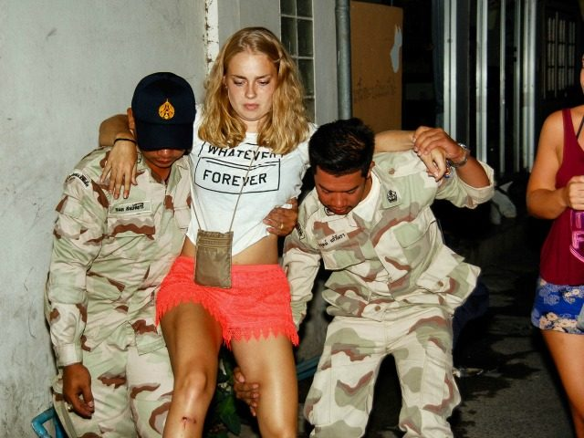 This photo taken on August 11, 2016 shows an injured tourist being helped after twin bombs exploded in the upscale resort of Hua Hin, Thailand. A string of bomb attacks targeting Thailand's crucial tourism industry have killed four people, officials said on August 12, sending authorities scrambling to identify a …