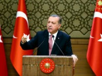 Turkish President Recep Tayyip Erdogan delivers a speech during an economic meeting with international investors at the Presidential Complex in Ankara on August 02, 2016. President Recep Tayyip Erdogan on August 2, 2016, launched his most bitter attack yet on Turkey's Western allies over the July 15 attempted putsch, accusing them of supporting both 'terror' and the coup plotters who tried to unseat him. Turkey meanwhile issued arrest warrants for about 100 staff, including doctors, at Ankara's main military hospital, in a new phase of the crackdown after the failed coup that has seen some 18,000 detained and caused international consternation. / AFP / TURKEY'S PRESIDENTIAL PRESS SERVICE / KAYHAN OZER (Photo credit should read KAYHAN OZER/AFP/Getty Images)
