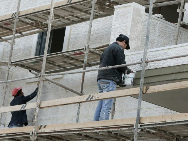 Thai laborers work in the construction of new house units in the Maaleh Hazeitim settlement, in the Ras al-Amud area of mostly arab east Jerusalem, on December 29, 2009. Israel has invited tenders for the building of hundreds of more homes in Jewish settlements in annexed Arab east Jerusalem, the …
