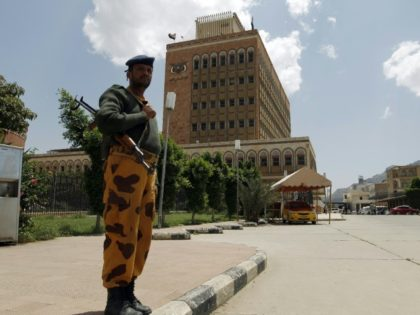 A Yemeni policeman stands in front of the Central Bank of Yemen in the capital Sanaa on August 25, 2016