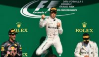 Mercedes driver Nico Rosberg (C) celebrates his win next to second placed Daniel Ricciardo (L) and third placed Lewis Hamilton at the Belgian Grand Prix in Spa on August 28, 2016