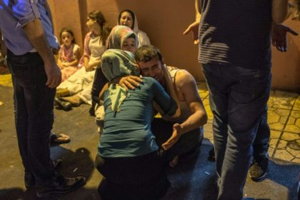 Relatives grieve at hospital in Gaziantep, southeast Turkey on August 20, 2016 following a late night militant attack on a wedding party
