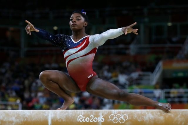 US gymnast Simone Biles competes in the Beam event during the women's team final Artistic Gymnastics at the Olympic Arena during the Rio 2016 Olympic Games in Rio de Janeiro on August 9, 2016