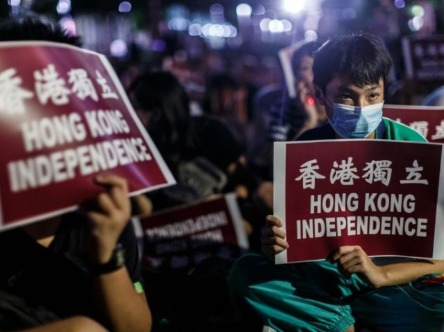 Protesters rally near the government's headquarters in Hong Kong on August 5, 2016 after five pro-independence candidates were barred from standing for election