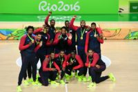 From L: The members of the USA men's basketball team celebrate with their gold medals