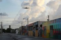 A plane sprays pesticide over the Wynwood neighborhood in the hope of controlling and reducing the number of mosquitos, some of which may be capable of spreading the Zika virus on August 6, 2016 in Miami, Florida