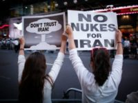 Women hold posters during a rally against the nuclear deal with Iran in New York in 2015