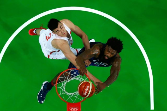 USA's DeAndre Jordan jumping for the basket as China's Wang Zhelin attempts a block during the match at the Carioca Arena 1 in Rio de Janeiro on August 6, 2016