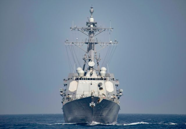 Iranian vessels came within 300 yards (meters) of an American destroyer, the USS Nitze, in the Strait of Hormuz, officials say