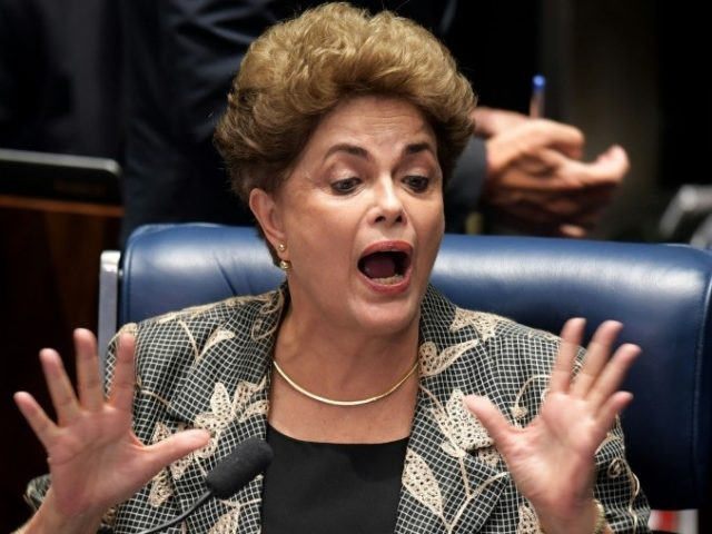 Impeached Brazilian President Dilma Rousseff gestures during her testimony in her impeachment trial at the National Congress in Brasilia