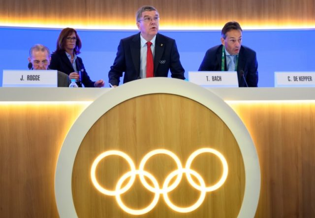 IOC President Thomas Bach (C) looks on next to former IOC President Jacques Rogge (L) and IOC Director General Christophe De Kepper at the opening of the 129th International Olympic Committee session, in Rio de Janeiro on August 2, 2016