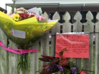 Flowers and messages are placed on a fence outside the hostel where British backpacker Mia Ayliffe-Chung, 21, was stabbed and killed on August 23, 2016, in Home Hill, Australia's rural Queensland