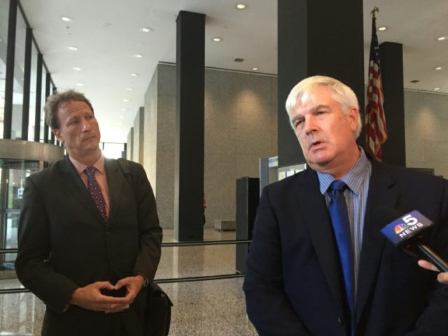 Attorney William Zieske (left) and his client Robert Fletcher (right) speak to reporters at the US federal courthouse in Chicago on August 23, 2016, after losing their lawsuit against artist Peter Doig