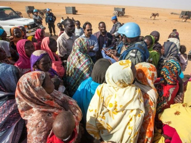 Displaced women discuss their concerns with UNAMID personnel at Zam Zam camp for internally displaced people, near El Fasher in North Darfur, on February 18, 2014
