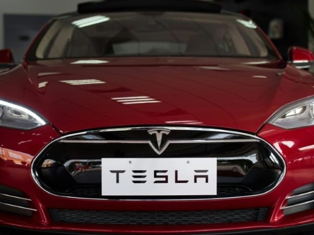 Tesla delivered 14,402 new vehicles in the quarter, with 9,764 of them being Model S sedans starting at $70,000