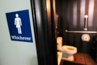 A gender neutral sign is posted outside a bathroom on May 11, 2016 in Durham, North Carolina