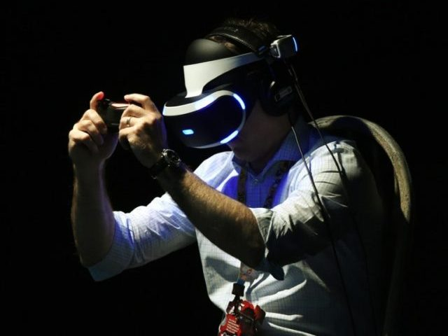 A gamer tests a new virtual reality game headset at the Electronic Entertainment Expo in Los Angeles, California