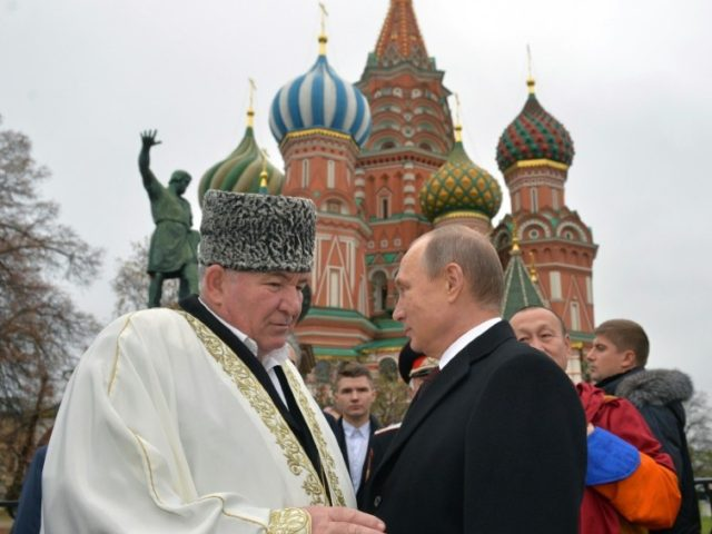 Russian President Vladimir Putin (right) speaks with Mufti Ismail Berdiyev during a 2015 ceremony in Moscow