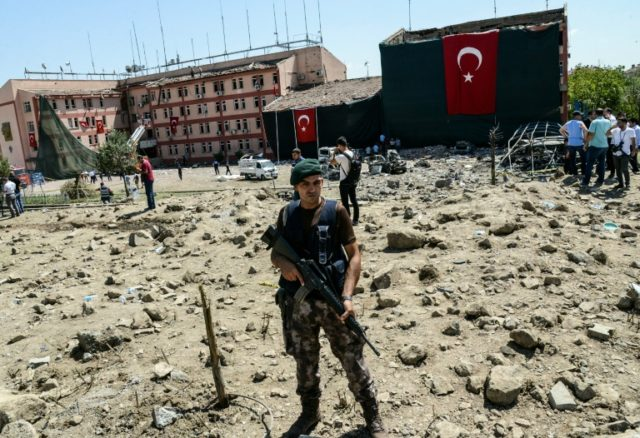 A Turkish soldier stands guard after a car bomb attack on a police station in the eastern city of Elazig, on August 18, 2016