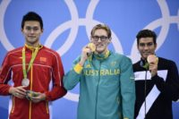 Australia's gold medallist Mack Horton (C), silver medallist China's Sun Yang (L) and bronze medallist Italy's Grabriele Detti pose on the podium after the Men's 400m Freestyle Final, at the Rio 2016 Olympic Games, on August 6