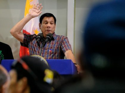 Philippines President Rodrigo Duterte speaksd uring a welcoming ceremony for repatriated overseas Filipino workers (OFW) from Saudi Arabia at the Manila International Airport in Manila on August 31, 2016