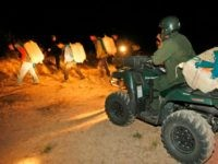 Bartletti, Don –– – MARCH 19, 2009. RODEO, NEW MEXICO. Veteran U.S. Border Patrol tracker Rogelio Villa and other agents move smugglers through the desert. The marijuana backpack on his ATV has blue shoulder straps fashioned from blankets. Villa and his team tracked the suspects for 6 hours before surrounding them. When confronted, 2 men in the group dropped their packs and escaped through the sandy desert valley near Rodeo, New Mexico. LATimes photo by Don Bartletti