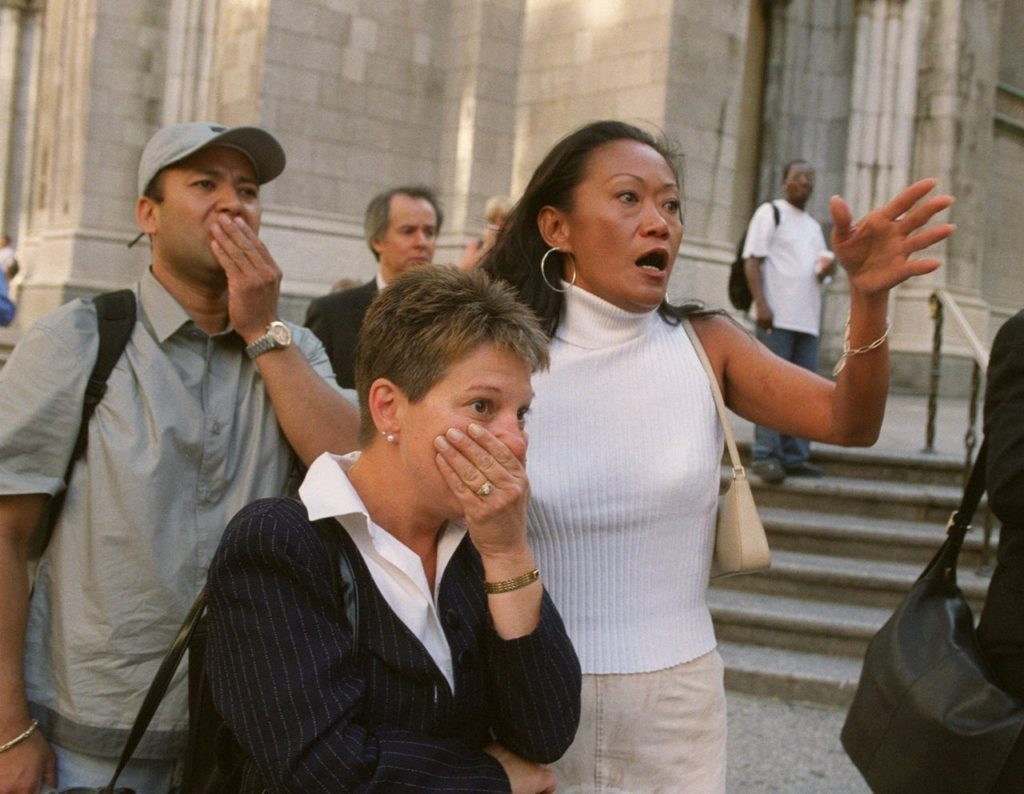 People in front of New York's St. Patrick's Cathedral react with horror as they look down Fifth Ave towards the World Trade Center towers after planes crashed into their upper floors in this Sept. 11, 2001, file photo. Explosions and fires collapsed the 110-story buildings. This year will mark the fifth anniversary of the attacks. (AP Photo/Marty Lederhandler/FILE)