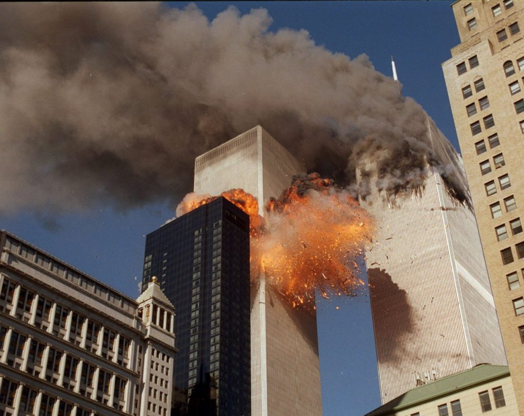 THIRD OF A SERIES OF FOUR PHOTOS--Smoke billows from one of the towers of the World Trade Center and flames and debris explode from the second tower, Tuesday, Sept. 11, 2001. In one of the most horrifying attacks ever against the United States, terrorists crashed two airliners into the World Trade Center in a deadly series of blows that brought down the twin 110-story towers. (AP Photo/Chao Soi Cheong)