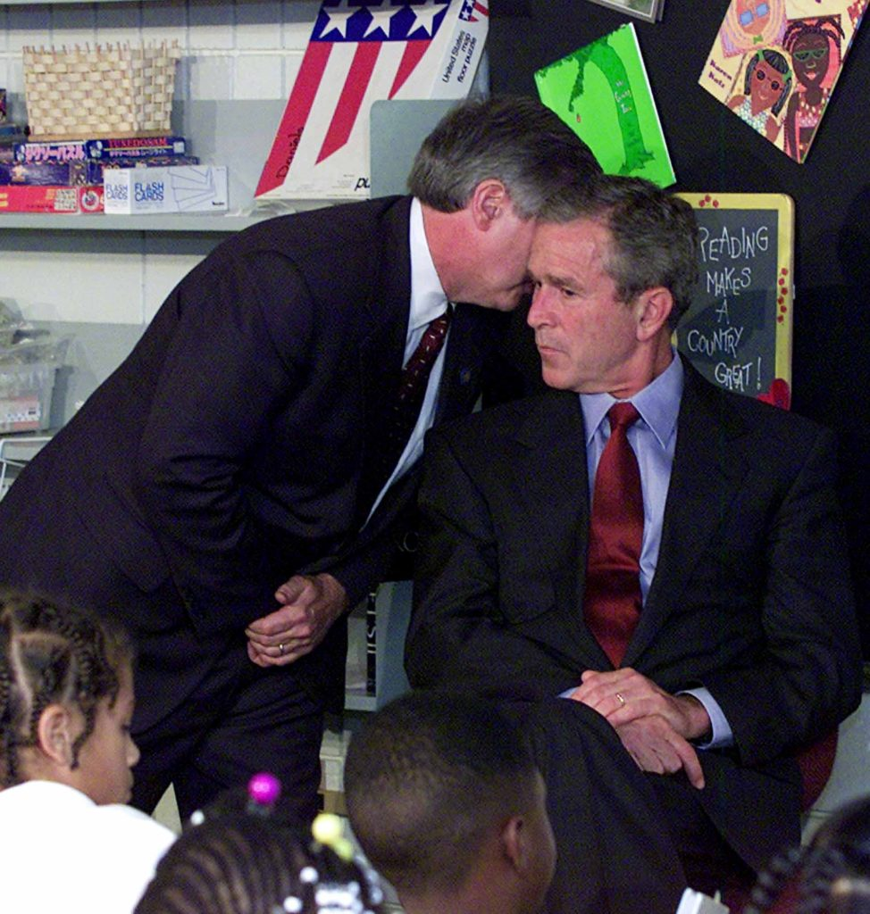President Bush's Chief of Staff Andy Card whispers into the ear of the President to give him word of the plane crashes into the World Trade Center, during a visit to the Emma E. Booker Elementary School in Sarasota, Fla., Tuesday, Sept. 11, 2001. (AP Photo/Doug Mills)