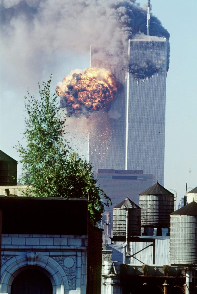 A fireball erupts from one of the World Trade Center towers as it is struck by the second of two airplanes in New York, Tuesday, Sept. 11, 2001. In a horrific sequence of destruction, terrorists hijacked two airliners and crashed them into the World Trade Center in a coordinated series of attacks that brought down the twin 110-story towers. (AP Photo/Todd Hollis)