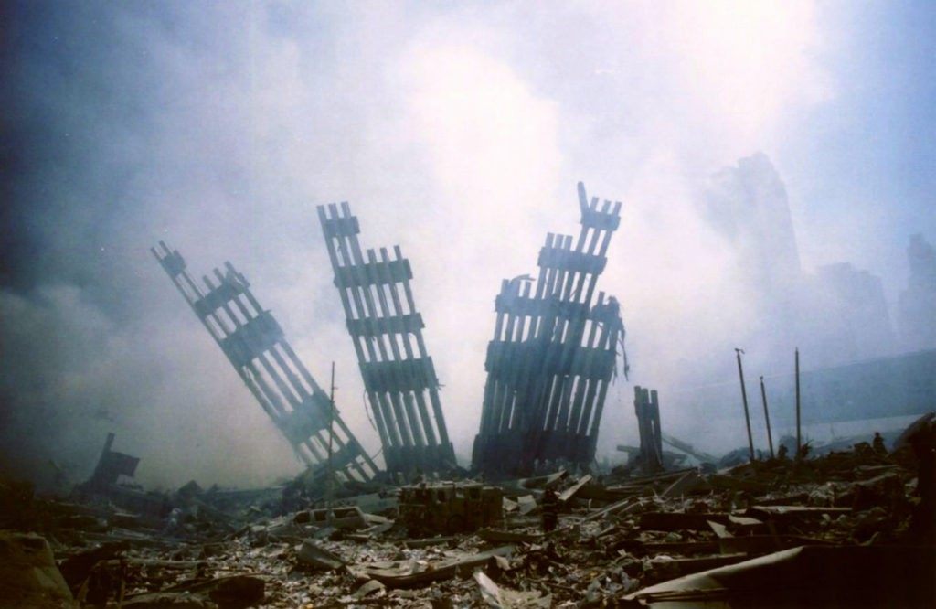 The remains of the World Trade Center stands amid the debris following the terrorist attack on the building in New York, Tuesday, Sept. 11, 2001. (AP Photo/Alexandre Fuchs)