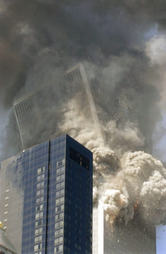 THEN--The south tower of the World Trade Center begins to collapse following the terrorist attack on the New York landmark Tuesday, Sept. 11, 2001. The Millenium Hilton hotel is in foreground. (AP Photo/Amy Sancetta)