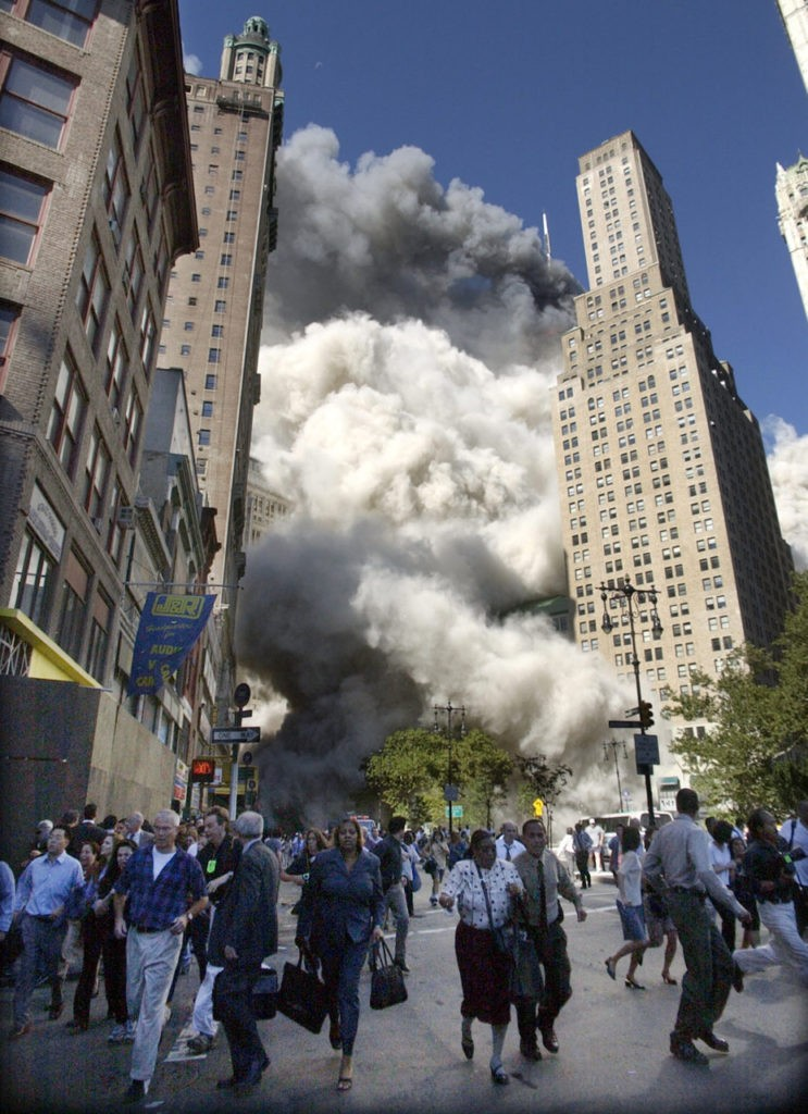People flee the falling South Tower of the World Trade Center on Tuesday, September 11, 2001. (AP Photo/Amy Sancetta)