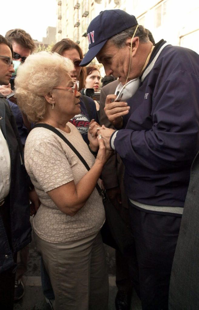 "New York City Mayor Rudolph Giuliani consoles Anita Deblase, of New York, whose son, James Deblase, 44, is missing, at the site of the World Trade Center disaster, Wednesday, Sept. 12, 2001. ""He's at the bottom of the rubble,"" she said. James Deblase worked for Cantor Fitzgerald at the World Trade Center. (AP Photo/Robert F. Bukaty)"