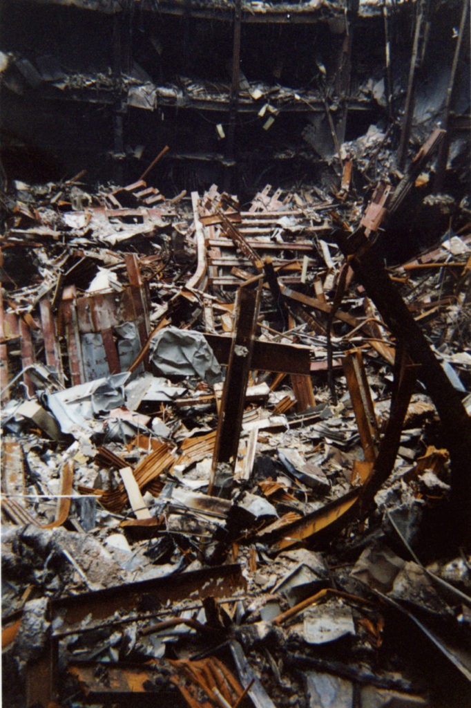 "This undated photo of two metal beams, center, that form a cross that rises out of the destruction at the World Trade Center, was made available in New York, Thursday, Oct. 4, 2001. The cast iron ""cross,"" which fell intact from Tower One into nearby Building Six on Sept. 11., was blessed on Thursday by Rev. Brian Jordan, a Franciscan priest, as rescue workers who have adopted it as a symbol of faith gathered around to watch. (AP Photo/Pool)"