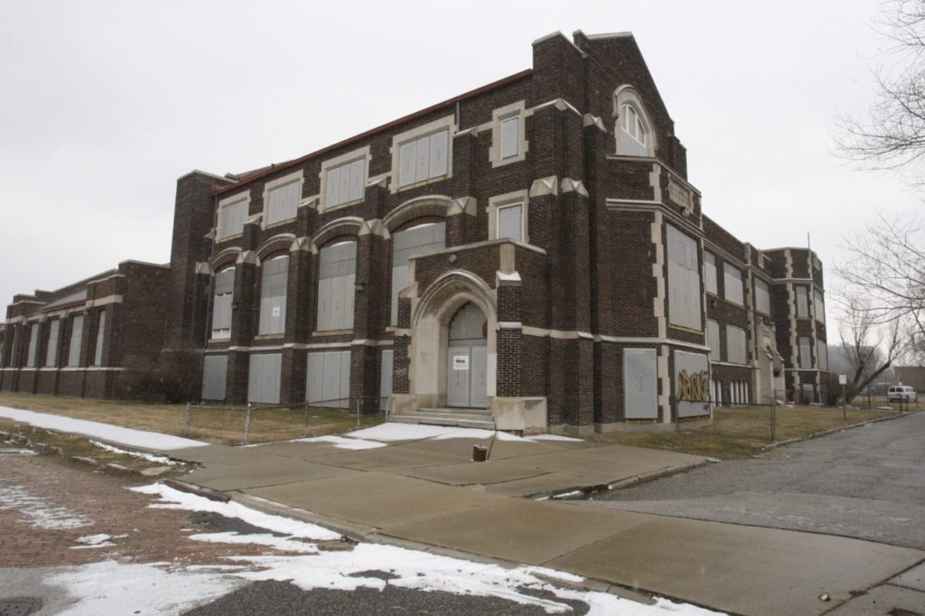 The boarded up Sidney Miller school is seen Tuesday, Feb. 2, 2010 in Detroit. A plan to shutter a quarter of Detroit's public schools in June will add 45 more empty buildings to dozens of district properties dominating already blighted neighborhoods. (AP Photo/Carlos Osorio)