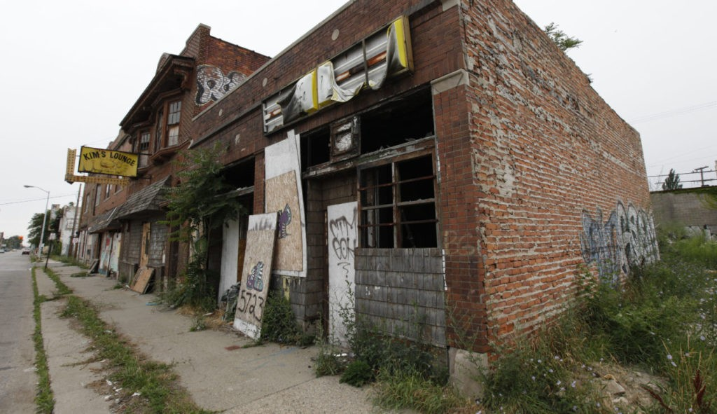 A section of vacant stores is shown in Detroit, Wednesday, July 27, 2011. Detroit's mayor unveiled a plan that could determine what the city looks like as it fights for vitality, announcing that neighborhoods will receive different kinds of services depending on the condition of homes, how many people live there and the level of blight. His plan isn't really about shrinking Detroit _ the 139-square-mile city's boundaries aren't receding. He instead wants to encourage redistribution of what's left of Detroit's population into areas where people still live, where houses aren't about to cave in and where the city's scant resources won't be spread dangerously thin. (AP Photo/Paul Sancya)