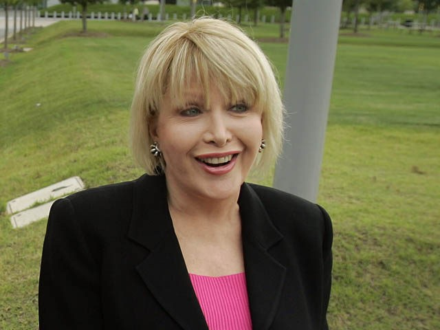 Gennifer Flowers, right, and Paula Jones are interviewed in front of the Clinton Presidential Library in Little Rock, Ark., Monday, June 9, 2008. (AP Photo/Danny Johnston)