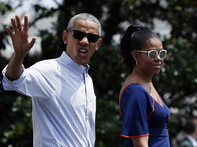 President Barack Obama waves and calls out to media as he and first lady Michelle Obama walk from the White House, Saturday, Aug. 6, 2016, in Washington, to board Marine One, with their daughters Sasha and Malia, en route to Andrews Air Force Base, Md., and on to Martha's Vineyard …
