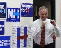 Democratic vice presidential candidate, Sen. Tim Kaine, D-Va. pumps his fists after being introduced during a campaign stop, Thursday, Sept. 1, 2016, in Dover, N.H. (AP Photo/Charles Krupa)