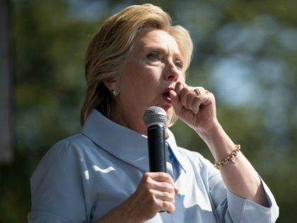 Democratic presidential candidate Hillary Clinton stops her speech to cough at the 11th Congressional District Labor Day festival at Luke Easter Park in Cleveland, Ohio, Monday, Sept. 5, 2016.