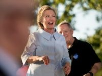 Democratic presidential candidate Hillary Clinton, accompanied by Sen. Dick Durbin, D-Ill., right, winks as she finishes speaking at the annual Salute to Labor at Illiniwek Park Riverfront in Hampton, Ill., Monday, Sept. 5, 2016. (AP Photo/Andrew Harnik)