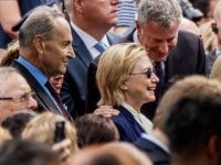 Democratic presidential candidate Hillary Clinton, center, accompanied by Sen. Chuck Schumer, D-N.Y., left, and Rep. Joseph Crowley, D-N.Y., second from left, speaks with New York Mayor Bill de Blasio, center right, during a ceremony at the Sept. 11 memorial, in New York, Sunday, Sept. 11, 2016. (AP Photo/Andrew Harnik)