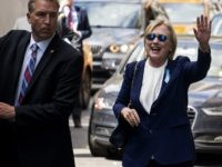 "Democratic presidential candidate Hillary Clinton waves as she walks from her daughter's apartment building Sunday, Sept. 11, 2016, in New York. Clinton unexpectedly left Sunday's 9/11 anniversary ceremony in New York after feeling ""overheated,"" according to her campaign. (AP Photo/Craig Ruttle)"